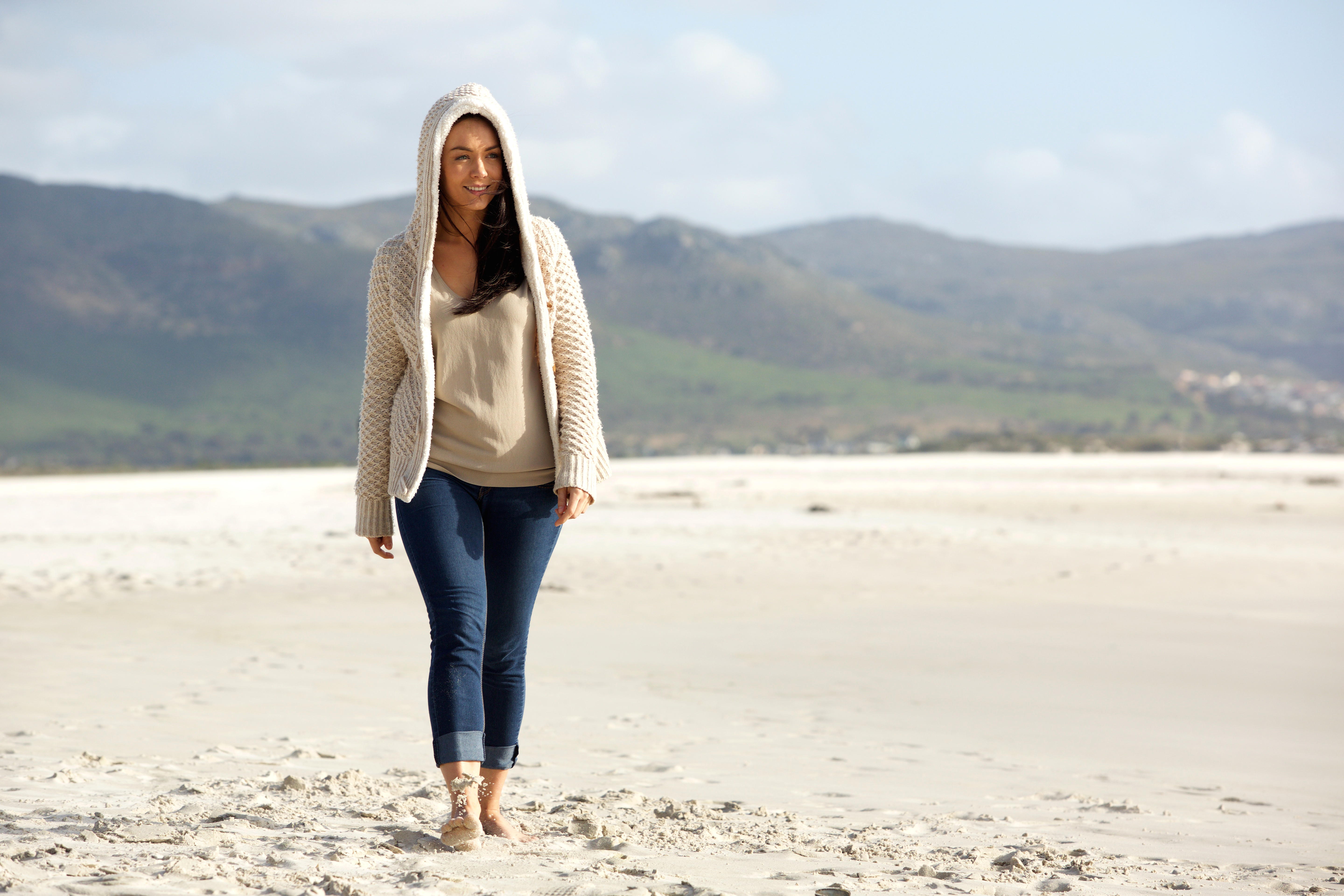 young-woman-walking-at-the-beach-PUVEP2Z.jpg